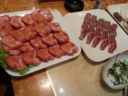 plates of sliced raw meat