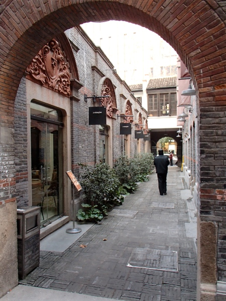 narrow lane between brick buildings