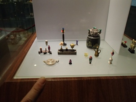 extremely tiny sculptures in a display case