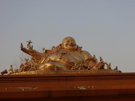 fat golden Buddha statue