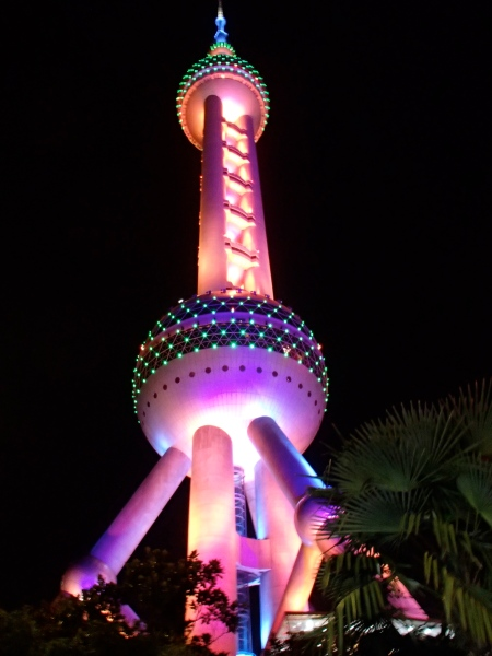 tower lit in multiple colors at night