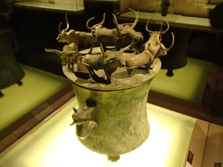bronze vessel with eight yaks on top