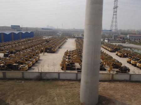 lot full of CAT heavy equipment vehicles