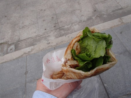 flat bread wrap with egg, cheese, and lettuce