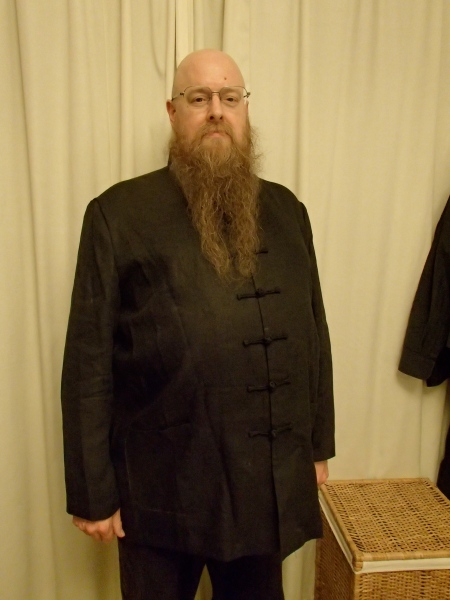 man in black linen Chinese tunic