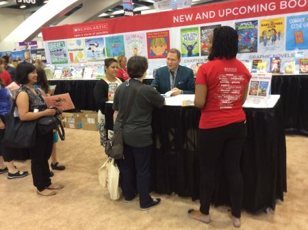 Dav Pilkey at the Scholastic Books booth signing books