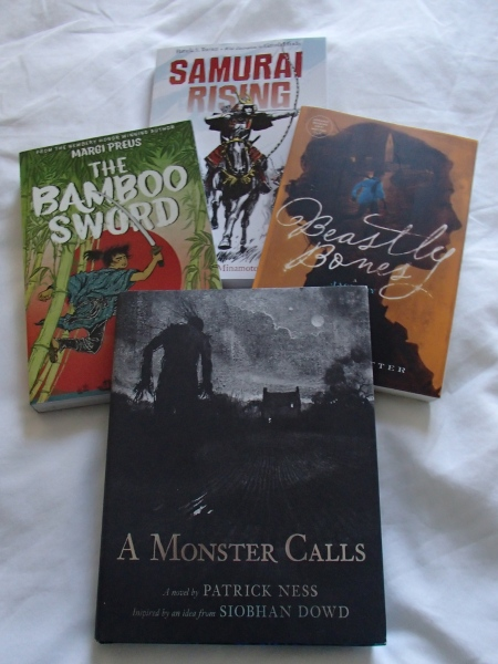 four books - Samurai Rising, Bamboo Sword, Beastly Bones, A Monster Calls
