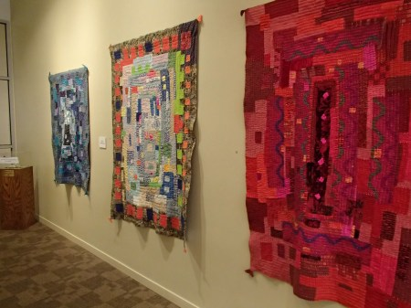 quilts hanging on a wall