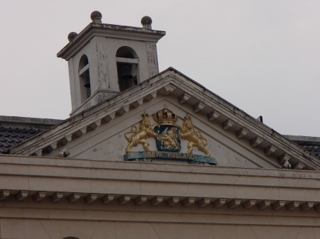 New Holland coat of arms on a two story restaurant building