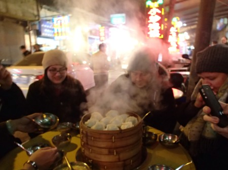 steaming basket of dumplings