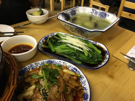 vegetable soup, cooked greens, spicy pork dish