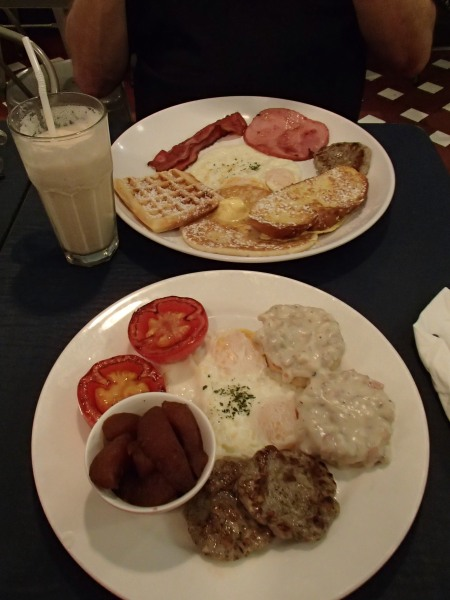 two plates of breakfast food