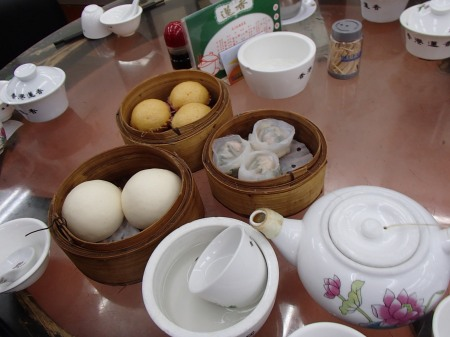bamboo steam baskets full of dim sum buns