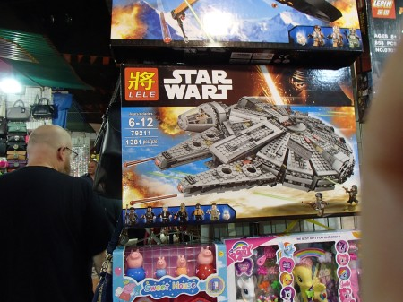 toy boxes, one of which is a Star Wart version of the Millennium Falcon