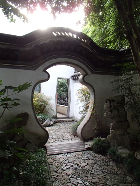 Chinese garden wall with vase shaped doorway