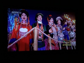Chinese women in traditional ethnic dress singing