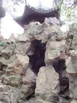 Manmade garden cave structure