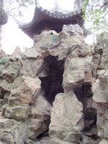 Manmade garden cave structure