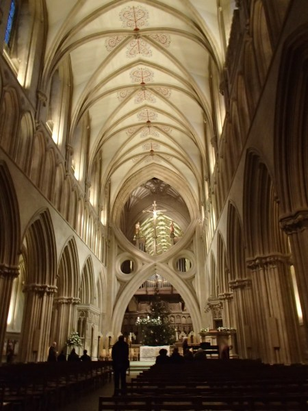 cathedral sanctuary with vaulted ceiling and scissor shaped arch