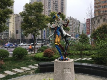 statue of two harlequin clowns