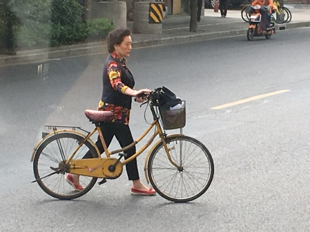 a woman with a vintage bicycle