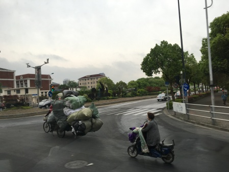three wheeled cycle loaded with recyclables