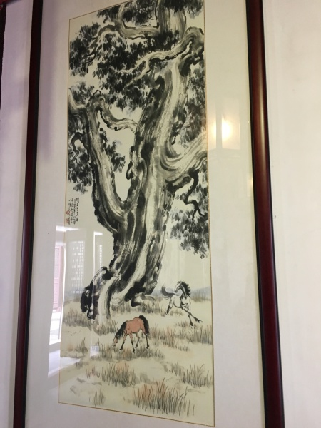 Chinese watercolor painting of a tree and two horses