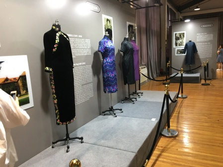 four Chinese qipao dresses on display