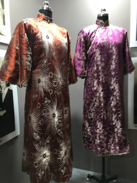 two loose fitting, embroidered qipao dresses