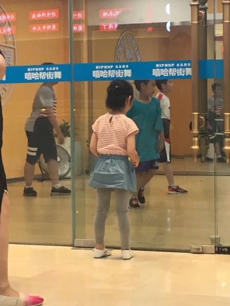 girl looking into dance studio