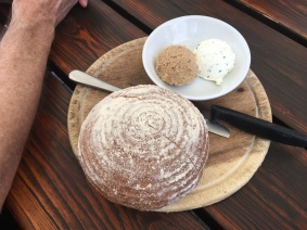 round loaf of bread with two spreads
