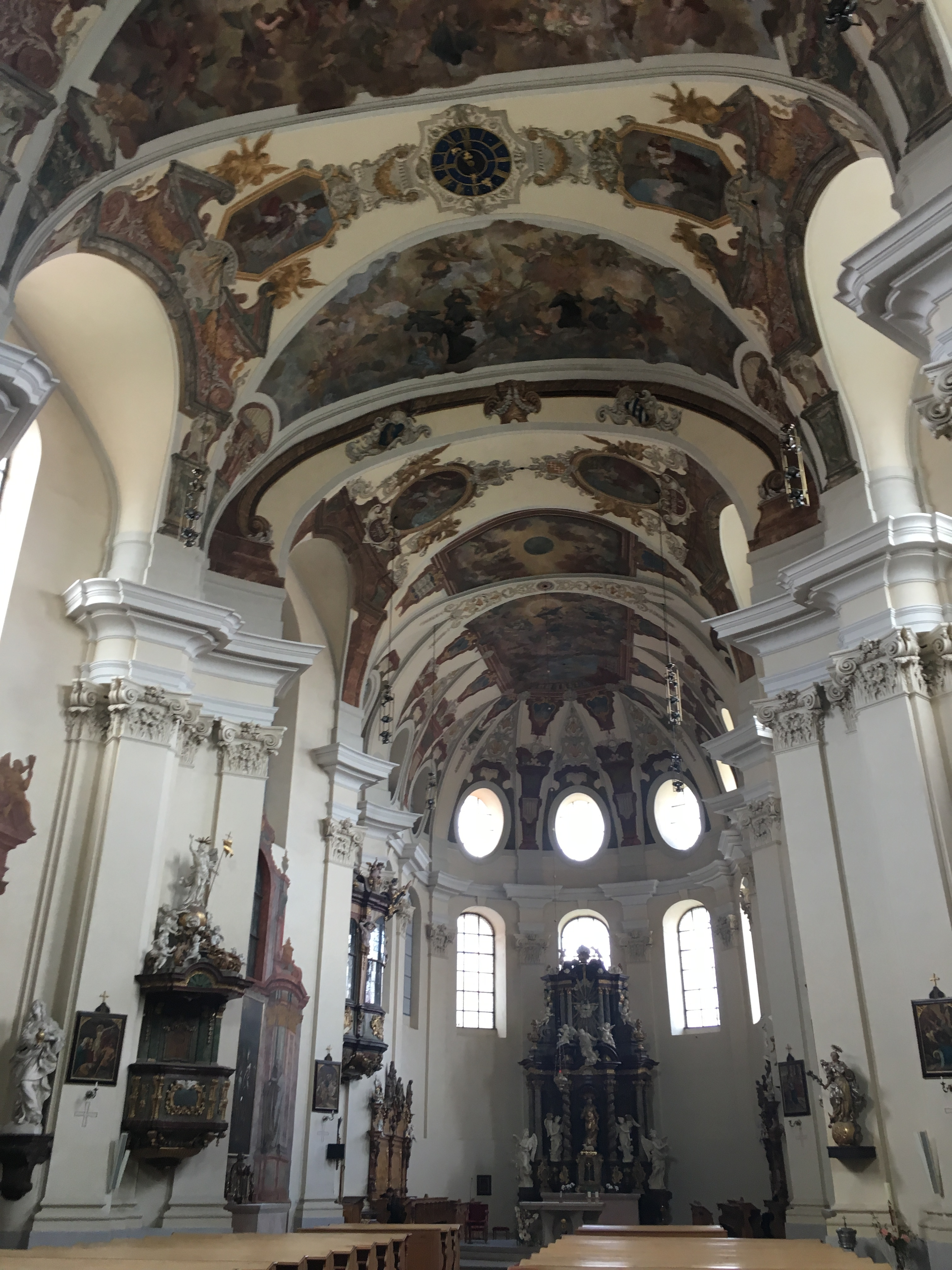 inside of the church with vaulted painted ceiling
