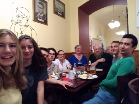 nine people at a pub table
