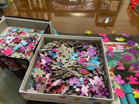 jigsaw puzzle pieces in a box