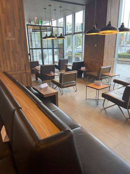coffee shop with chairs arranged singly to keep people from sitting together or face to face