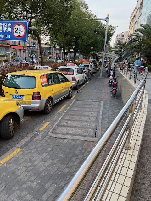 line of taxis waiting in front of a major grocery store