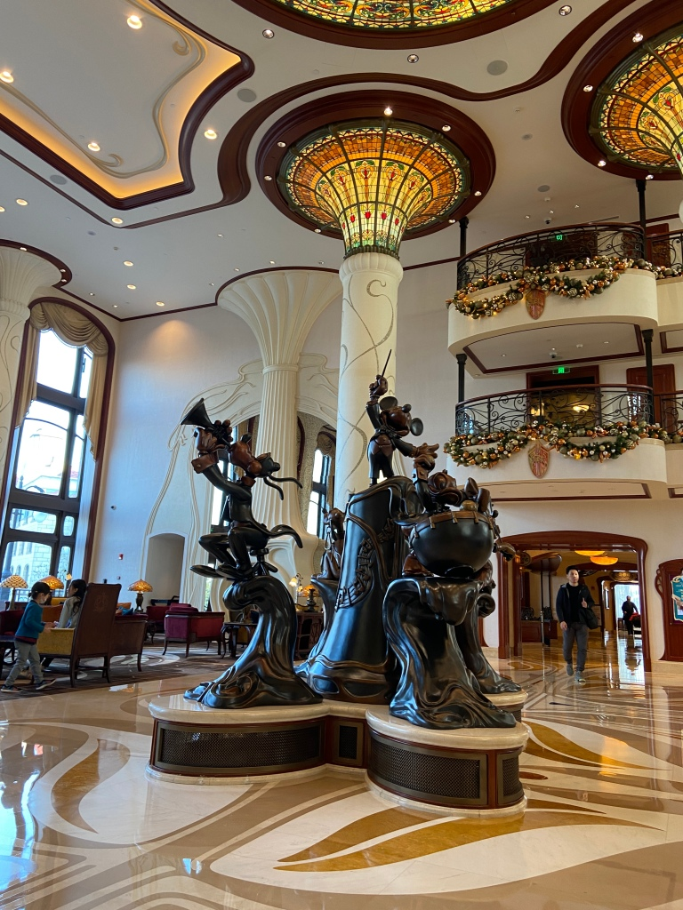 Statue of Disney characters in the lobby of the Shanghai Disneyland Hotel